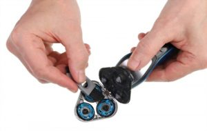 Brushing out cutters of rotary shaver